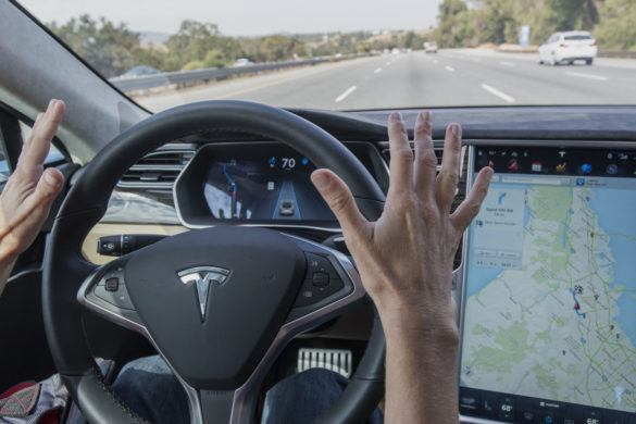 "A member of the media test drives a Tesla Motors Inc. Model S car equipped with Autopilot in Palo Alto, California, U.S., on Wednesday, Oct. 14, 2015. Tesla Motors Inc. will begin rolling out the first version of its highly anticipated ""autopilot"" features to owners of its all-electric Model S sedan Thursday. Autopilot is a step toward the vision of autonomous or self-driving cars, and includes features like automatic lane changing and the ability of the Model S to parallel park for you. Photographer: David Paul Morris/Bloomberg via Getty Images"